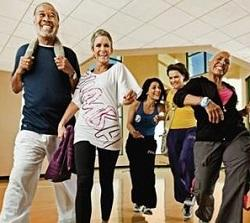 Group of adults smiling about a fitness class they are about to start or just concluded