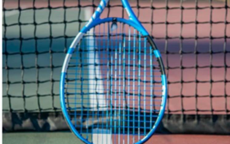 Tennis Ball and racquet on a tennis court
